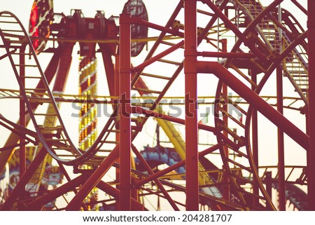 roller coaster at sunset - stock photo