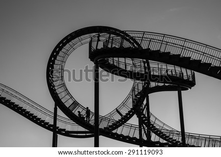 Roller coaster in silhouette - stock photo