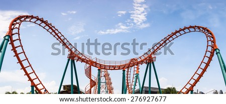 Roller Coaster, rail way curve and spin heart shape as panorama background - stock photo