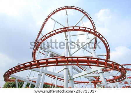Roller coaster with blue sky background in theme park - stock photo