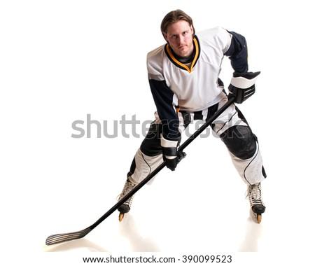 Roller hockey player. Studio shot over white. - stock photo