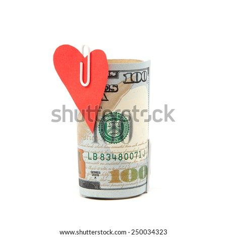 Roller hundred dollar bills with a heart isolated on white background. - stock photo
