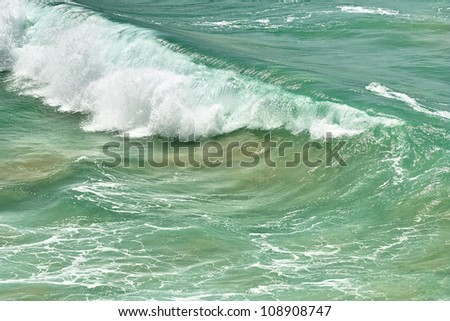 Roller ocean wave with white foam. Close-up image - stock photo