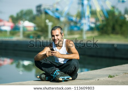 Roller sit on stairs, relaxing  and listening to the music - stock photo
