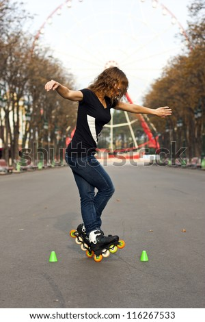 Roller skate girl skating. Young woman putting on skates going rollerblading in urban city park. Beautiful young woman - stock photo