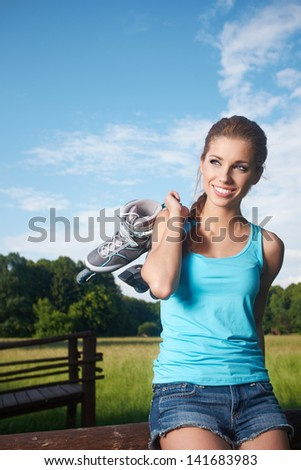Rollerblade / roller skating woman in park - stock photo