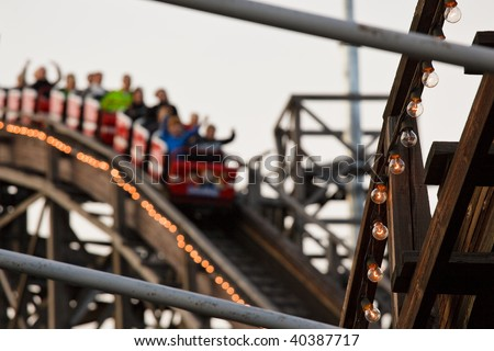 Rollercoaster at Theme Park - stock photo