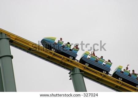 Rollercoaster climbing - stock photo