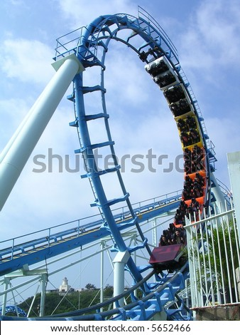 Rollercoaster & cloudy blue sky - stock photo