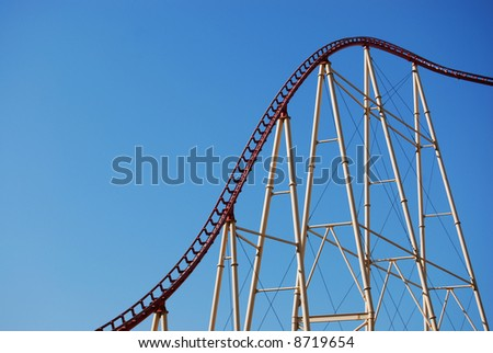 rollercoaster frame against blue sky - stock photo