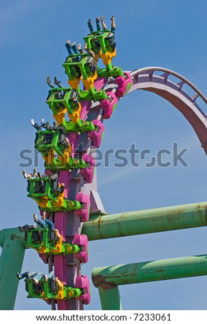 Rollercoaster loop against a brilliant blue sky - stock photo