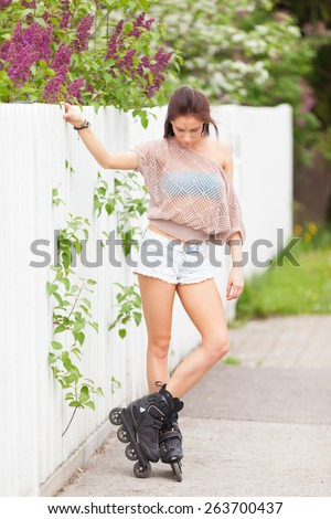 Rollergirl preparing for a ride - stock photo