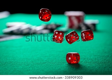 Rolling Casino Dice - stock photo