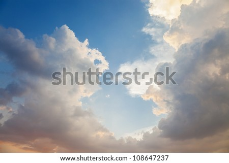 rolling clouds near sunset - stock photo