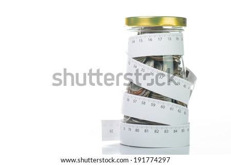 Rolling deposit money by Measuring tape for tie your budget. - stock photo