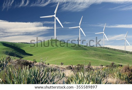 rolling hills in the country and wind generators - stock photo