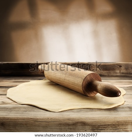 rolling pin and cake of pizza  - stock photo