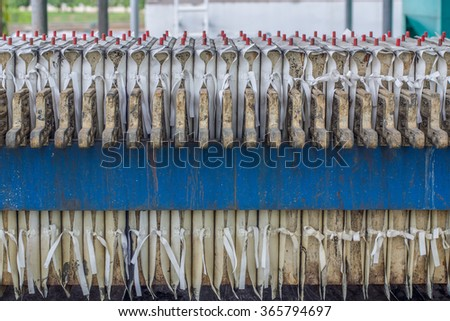 Rolling sewage sludge - stock photo
