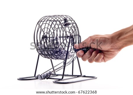 Rolling The Bingo Ball Cage - stock photo