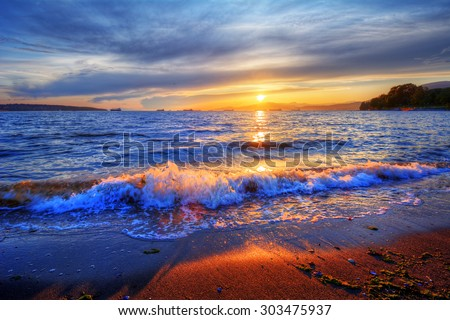 Rolling waves along the shore - stock photo