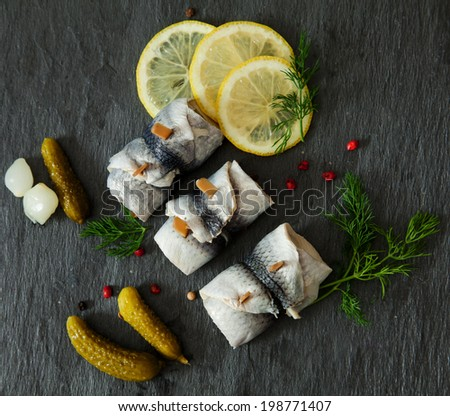 Rollmops - pickled herring fillets with lemon - stock photo