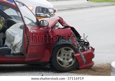 Rollover Vehicle Accident at Busy Intersection With Emergency Personnel to Assist - stock photo