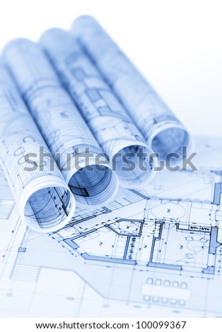 rolls of architecture blueprints & house plans - stock photo