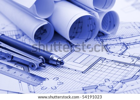 rolls of blueprints & work tools - ruler, pencil, compass - stock photo