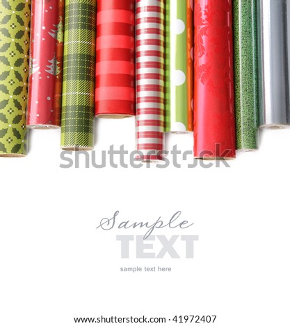 Rolls of colored wrapping  paper on white background - stock photo