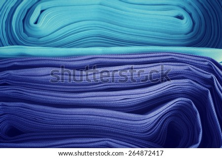 Rolls of colorful fabric  - stock photo
