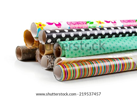 rolls of colorful wrapping paper isolated on white - stock photo