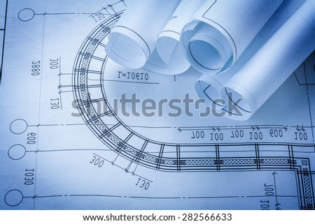 Rolls of construction plans building and architecture concept  - stock photo