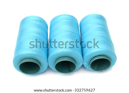 rolls of cotton on white  - stock photo