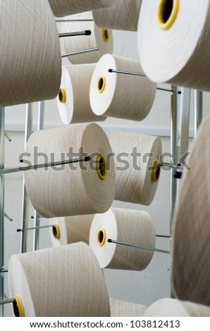 Rolls of industrial cotton fabric for clothing cloth textile manufacture on machine - stock photo