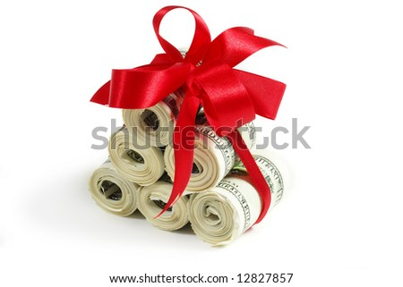 Rolls of money wrapped in red bow and ribbon - stock photo