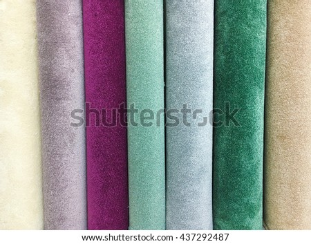 Rolls of new carpet in a homeware store - stock photo