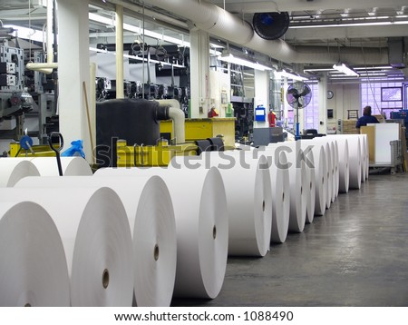 Rolls of paper lined up for printing press - stock photo