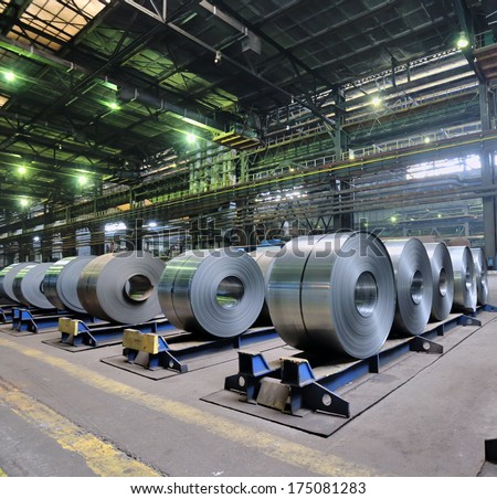 rolls of steel sheet in a plant, galvanized steel coil - stock photo