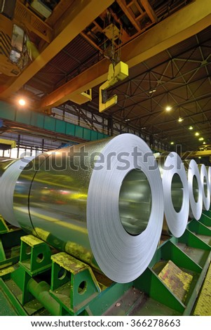 rolls of steel sheet stored in warehouse - stock photo