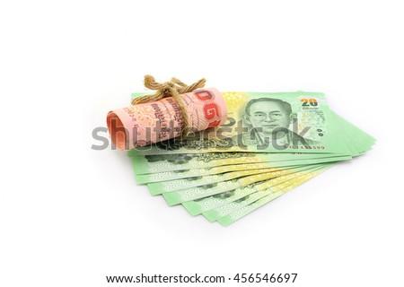 Rolls of Thai Bath, banknotes on white background - stock photo