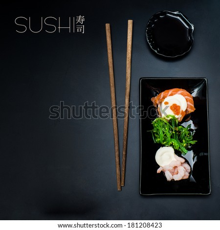 rolls on a rectangular plate on a black background with space for text - stock photo