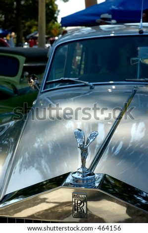 Rolls Royce with woman inside on back seat - stock photo