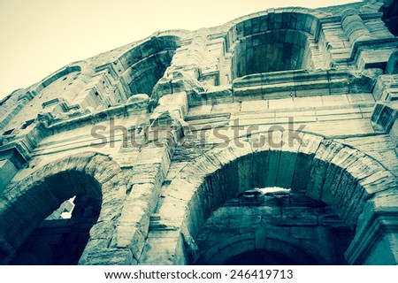 Roman amphitheatre in Arles (Bouches-du-Rhone, Provence-Alpes-Cote d'Azur, France) Aged photo.  - stock photo