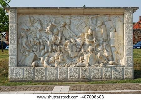 Roman and Dacian war fight scene on a relief in Carolina Citadel in Alba Iulia, Romania - stock photo