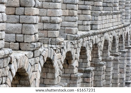 Roman aqueduct bridge of Segovia  Spain was built around the 1st century AD, during the time of the EmperorTrajan, Claudius or Nerva, it takes water 17km from the Fuente Fria river. - stock photo