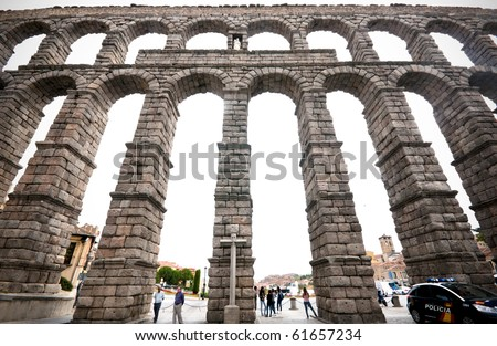 Roman aqueduct bridge of Segovia  Spain was built around the 1st century AD, during the time of the Emperor Trajan, Claudius or Nerva, it takes water 17km from the Fuente Fria river.  It ha no mortar - stock photo