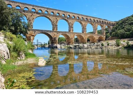 Roman aqueduct Pont du Gard, near Nimes, Languedoc, France, Europe. Unesco World Heritage site - stock photo