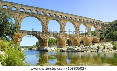 Roman aqueduct Pont du Gard, Unesco World Heritage site. Located near Nimes, Languedoc, France, Europe. - stock photo