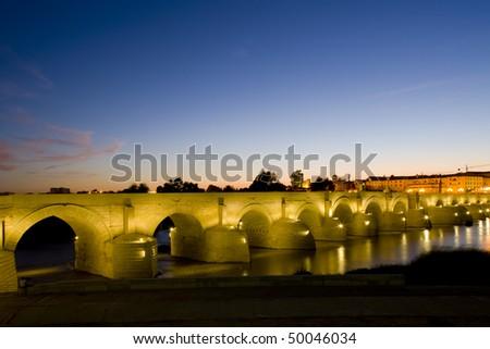 Roman bridge at night, Cordoba, Andalusia, Spain - stock photo
