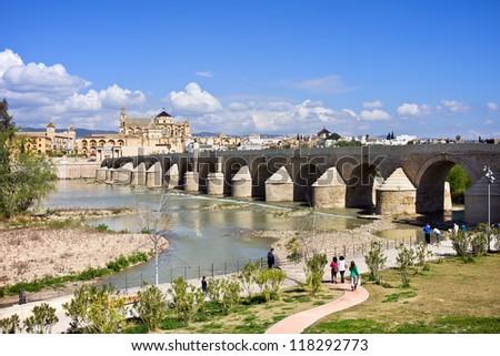 Roman Bridge on Guadalquivir river in the city of Cordoba in Spain, Andalusia region. - stock photo